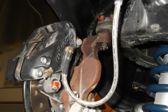 125 note small size of front calipers and orange inspection paint as indication of torque checked