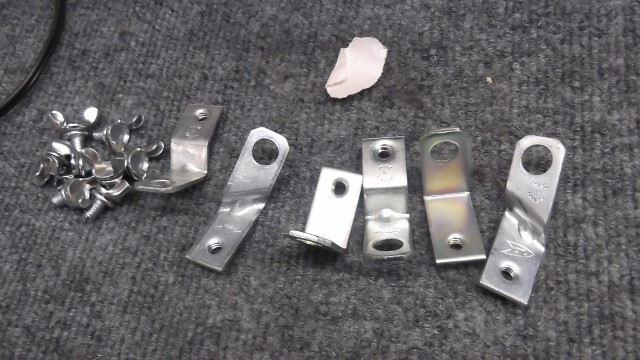 160 spark plug shielding brackets are repro and need replated