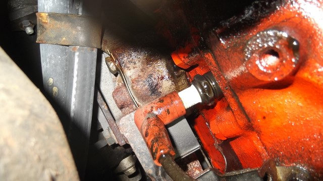 108 oil slung on plug boot - dripping from exh manifold