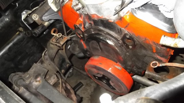 121 water pump removed - block and timing chain cover are painted black and grease covered