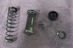 129 master cylinder piston removed -note the sludge